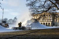 Snowmaking in Oslo in January - national palace grounds